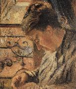 The Woman is sewing in front of the window