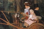 The woman and the child are driving the carriage