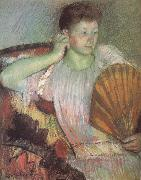 The woman taking the fan