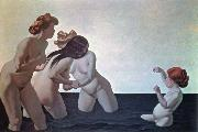 three women and a young girl playing in the water