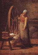 The woman weaving the sweater