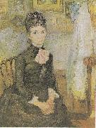 Woman sitting next to a cradle