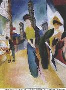 Two women in front of a hat shop