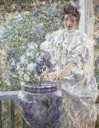 Woman with a Vase of Irises