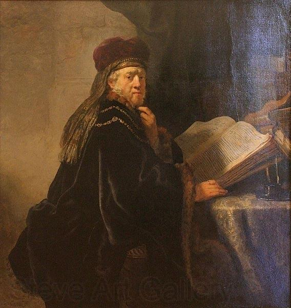 REMBRANDT Harmenszoon van Rijn A Scholar Seated at a Desk